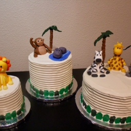 Jungle themed trio of cakes with custom fondant animals for a sweet baby shower